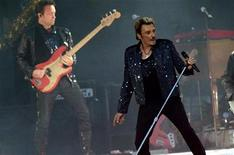 <p>French rock singer Johnny Hallyday performs at the Stade de France in Saint Denis, Paris suburb, May 29, 2009. REUTERS/Philippe Wojazer</p>