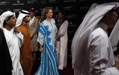 <p>Queen Noor Al Hussin of Jordan, widow of the late King Hussein, arrives at the opening ceremony of the (DIFF) DubaiInternational Film Festival in Dubai December 9, 2009.REUTERS/Mosab Omar</p>