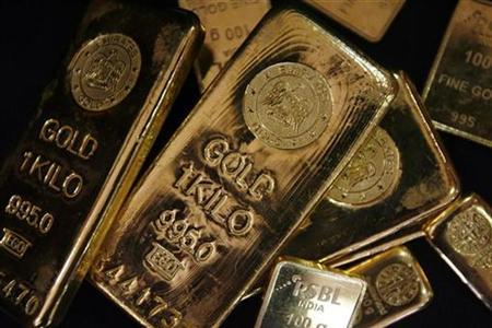 Gold bars are displayed to be photographed at bullion house in Mumbai in this December 3, 2009 file photo. REUTERS/Arko Datta