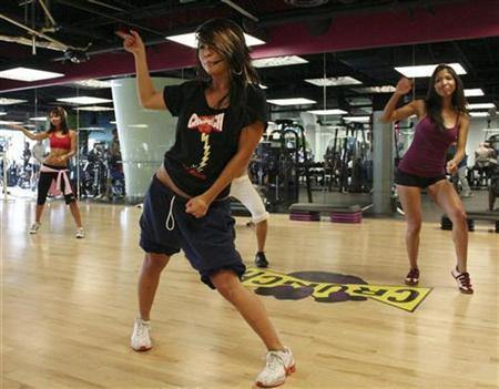 People participate in a Cardio Go Go class at Crunch Fitness in Los Angeles in this undated handout. REUTERS/Crunch Fitness/Handout
