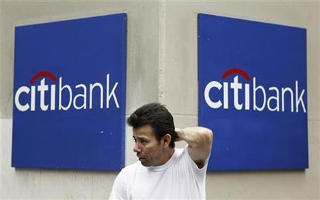 A man stands outside a Citibank branch in New York August 13, 2009. REUTERS/Lucas Jackson