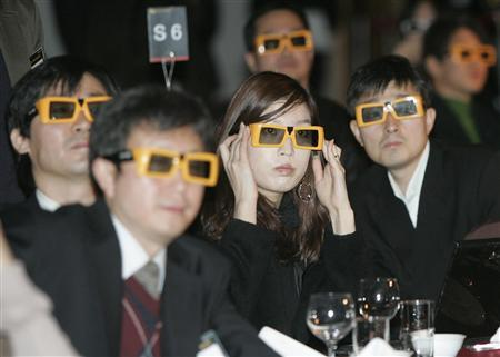 Participants wearing special glasses for a 3D TV watch a 3D movie through LG Electronics' 3D TV during the company's 3D television strategy presentation at LG Electronics' R&D centre in Seoul December 15, 2009. REUTERS/Choi Bu-Seok