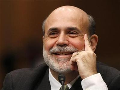 Federal Reserve Chairman Ben Bernanke smiles during comments made by a senator during a Senate Banking, Housing and Urban Affairs Committee hearing on his nomination to continue as Chairman of the Board of Governors, on Capitol Hill in Washington, December 3, 2009. REUTERS/Jason Reed