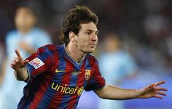 <p>O argentino Lionel Messi, do Barcelona, comemora seu gol no jogo contra o Atlante, em Abu Dhabi. REUTERS/Fadi Al-Assaad</p>