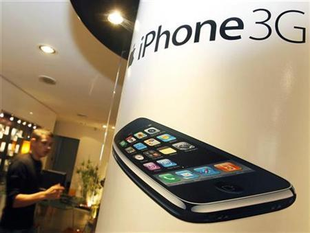 An advertisement for the Apple iPhone is shown at a retail store of an Orange mobile phone network provider in Bordeaux, southwestern France, October 23, 2009. REUTERS/Regis Duvignau
