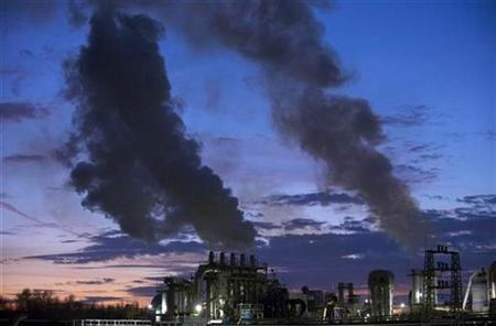 Smoke billows from the chimneys of a wood products factory near the city of Burgos, northern Spain December 9, 2009. REUTERS/Felix Ordonez