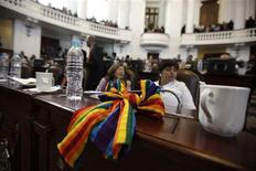 <p>A rainbow ribbon sits on the desk of delegates at the city's assembly in Mexico City December 21, 2009. REUTERS/Daniel Aguilar</p>
