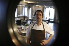 <p>Chef Rene Redzepi is seen through a window as he poses in his Noma restaurant in Copenhagen December 12, 2009. REUTERS/Christian Charisius</p>