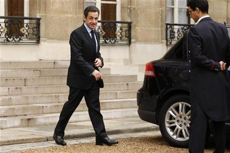 France's President Nicolas Sarkozy leaves the Elysee Palace in Paris December 22, 2009. REUTERS/Benoit Tessier