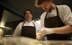 <p>Chef Rene Redzepi (L) poses in the kitchen of his Noma restaurant in Copenhagen December 12, 2009. REUTERS/Christian Charisius</p>
