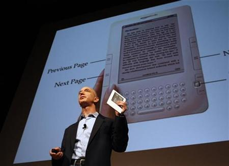 Amazon.com founder and CEO Jeff Bezos holds the Kindle 2 electronic reader at a news conference in New York where the device was introduced in this February 9, 2009 file photo. REUTERS/Mike Segar