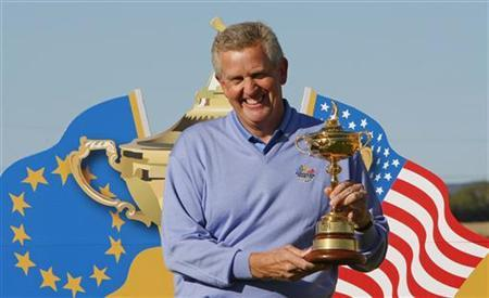 2010 Ryder cup captain Colin Montgomerie of Europe poses with the Ryder Cup trophy during a captain's exhibition match over nine holes at the Celtic Manor Resort in Newport, south Wales in this October 12, 2009 file photo. REUTERS/Phil Noble