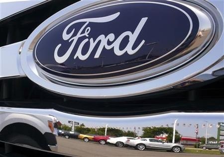 A Ford logo reflects a car dealership in Manassas, Virginia, August 3, 2009. REUTERS/Larry Downing