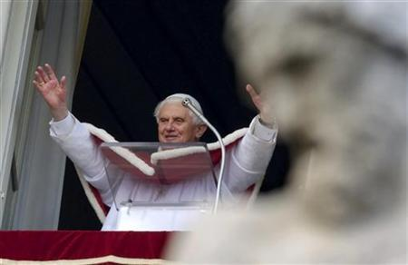 Pope Benedict XVI waves as he leads his Angelus prayer from the window of his private apartments at the Vatican January 10, 2010. REUTERS/Max Rossi