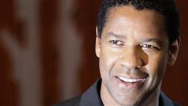 """<p>Denzel Washington, em foto de arquivo, é guardião da Bíblia no drama """"Eli"""". REUTERS/Tobias Schwarz</p>"""