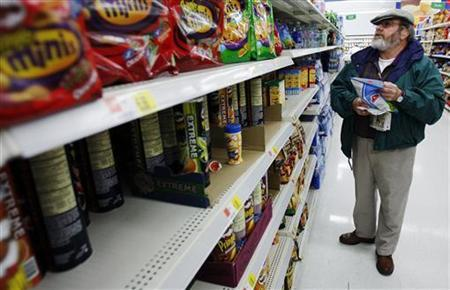 Michael Lipsitz picks out a bag of chips while grocery shopping at the WalMart in Crossville, Tennessee March 21, 2008. REUTERS/Brian Snyder