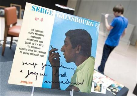 An record autographed by late French singer Serge Gainsbourg, to late Belgium singer Jacques Brel, is displayed during an exhibition with personal effects at Sotheby's auction house in Paris October 3, 2008. REUTERS/Gonzalo Fuentes