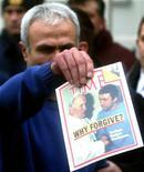 <p>Mehmet Ali Agca, l'uomo che sparò a Giovanni Paolo II nel 1981, in una foto d'archivio. REUTERS/STR New</p>