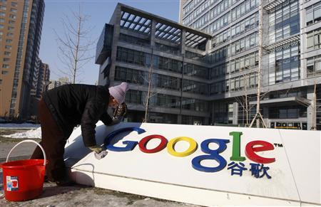 A woman cleans the logo of Google China outside the company headquarters in Beijing January 14, 2010. REUTERS/Jason Lee