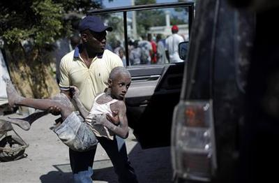 Haiti says 200,000 may be dead, violence breaks out