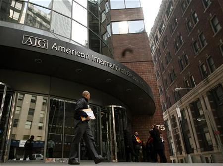 A man walks past the American International Group (AIG) building in New York's financial district in this March 16, 2009 file photo. REUTERS/Brendan McDermid