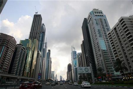 Motorists drive along Sheikh Zayed road in Dubai December 25, 2009. REUTERS/Mosab Omar