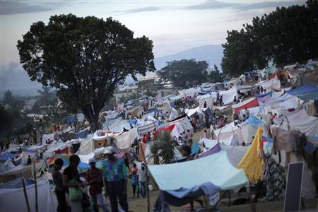 A view of a makeshift refugee camp, where at least 50,000 people are staying, on the golf course of the Petion Club in Port-au-Prince January 18, 2010. REUTERS/Jorge Silva