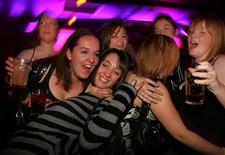 <p>Revellers enjoy themselves in a pub in Newcastle town centre, November 23, 2005. REUTERS/Jeff J. Mitchell</p>