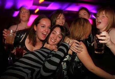 Revellers enjoy themselves in a pub in Newcastle town centre, November 23, 2005. REUTERS/Jeff J. Mitchell