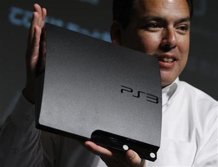 Sony Computer Entertainment Japan President Shawn Layden holds up the company's new PS3 game console in Tokyo August 19, 2009 file photo. REUTERS/Yuriko Nakao