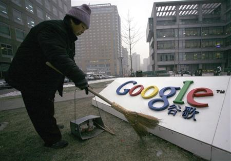 A cleaner sweeps the logo of Google China outside its company headquarters in Beijing, in this January 19, 2010 file photo. China's ambitions, and how they might be affected by the Google controversy, are likely to be a hot topic at next week's annual meeting of the World Economic Forum in Davos and beyond. Seemingly effortlessly, China has amassed the world's biggest stockpile of foreign exchange reserves, is overtaking Germany as the biggest exporting nation and now has a car market bigger than America's. Picture taken January 19, 2010. REUTERS/Alfred Jin/Files