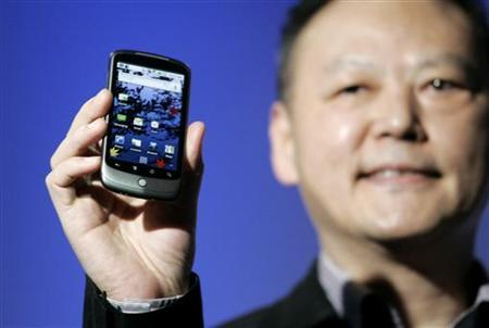 Peter Chou, chief executive of HTC, holds the Google Nexus One smartphone his company will produce, running the Android platform, during the unveiling of the first mobile phone the internet company will sell directly to consumers, during a news conference at Google headquarters in Mountain View, California January 5, 2010. REUTERS/Robert Galbraith