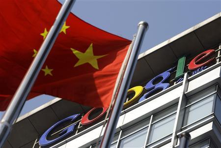 A Chinese national flag sways in front of Google China's headquarters in Beijing, January 14, 2010. REUTERS/Jason Lee