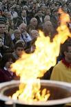 <p>Una cerimonia in ricordo dell'Olocausto. REUTERS/Valentin Flauraud</p>