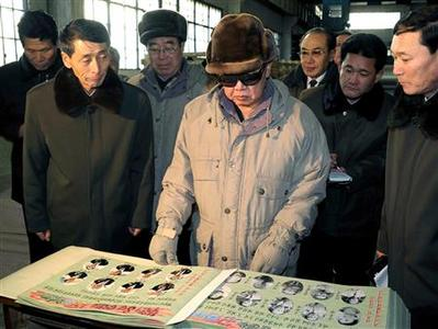 North Korean leader Kim Jong-il (C) visits the Rakwon Machine Complex in North Pyongan province in this picture released by the North's KCNA news agency late January 26, 2010. REUTERS/KCNA