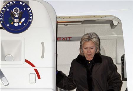 Secretary of State Hillary Clinton exits her aircraft after arriving at Stansted Airport in southern England, January 27, 2010. REUTERS/Suzanne Plunkett