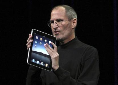 Apple Chief Executive Officer Steve Jobs holds the new '' iPad'' during the launch of Apple's new tablet computing device in San Francisco, January 27, 2010. REUTERS/Kimberly White