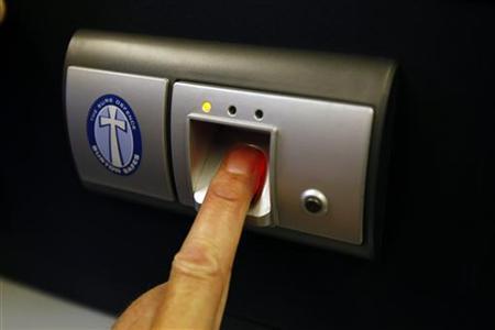 A fingerprint scanner is shown in Lichfield, central England, June 19, 2009. REUTERS/Phil Noble (BRITAIN)