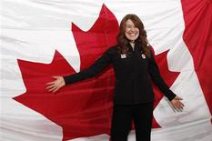 <p>Speedskater Clara Hughes stands in front of a Canadian flag after being named the flag bearer for the 2010 Winter Olympic opening ceremony at a news conference in Richmond, British Columbia January 29, 2010. The 2010 Olympic Winter Games begin February 12. REUTERS/Andy Clark</p>