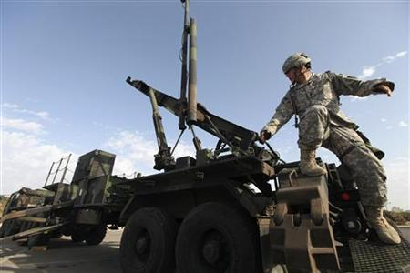 A U.S Army officer stands on a launcher for a Patriot missile interceptor during a joint Israeli-U.S. air-defence exercise dubbed 'Juniper Cobra', in Tel Aviv October 27, 2009. REUTERS/Ziv Koren/Pool