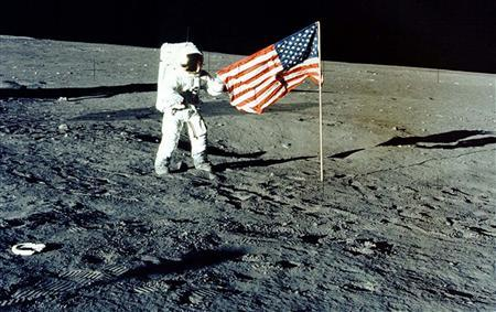Charles ''Pete'' Conrad Jr. stands with the U.S. flag on the lunar surface during the 1969 Apollo 12 mission. REUTERS/NASA/Handout