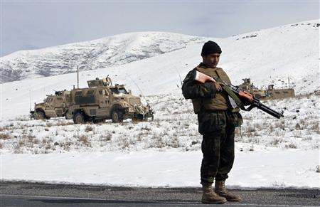 An Afghan National Army soldier stands watch near the site where Afghan National Army and NATO troops clashed in Wardak province southwest of Kabul January 30, 2010. REUTERS/Mustafa Andalib