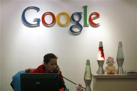 An employee works at the reception desk of Google's Hong Kong office January 14, 2010. REUTERS/Tyrone Siu