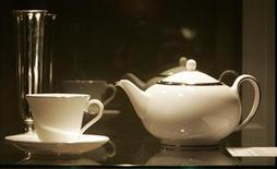 "<p>A Wedgwood teapot, cup and saucer and a silverplate bud vase used on stage during Barbra Streisand's 2004 concert for John Kerry in Los Angeles is displayed at a press preview of items from the auction ""The Collection of Barbra Streisand"" in Beverly Hills October 12, 2009. REUTERS/ Fred Prouser</p>"