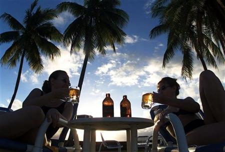 Tourists have a beer in Fiji in a file photo. REUTERS/Jason Reed