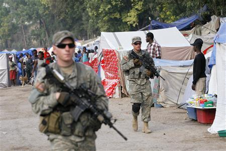 U.S. soldiers provide security at the Petionville Club makeshift camp in Port-au-Prince February 9, 2010. The 7.0 magnitude quake which struck Haiti on Jan. 12 is estimated to have killed up to 200,000 people. REUTERS/Kena Betancur