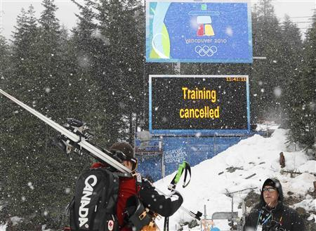 A scoreboard announces the cancellation of the training practice for the women's Downhill race of the Vancouver 2010 Winter Olympics in Whistler, British Columbia, February 11, 2010. REUTERS/Leonhard Foeger