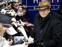 "<p>Actor Pierce Brosnan signs autographs as he arrives for a photocall to promote the movie ""The Ghost Writer"" at the Berlinale International Film Festival in Berlin February 12, 2010. REUTERS/Fabrizio Bensch</p>"