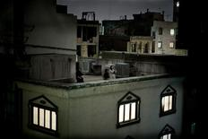 <p>Pietro Masturzo, an Italian freelance photographer, won the World Press Photo of the Year 2009 award with this picture of women shouting in protest from a rooftop in Tehran, on 24 June. REUTERS/Pietro Masturzo</p>