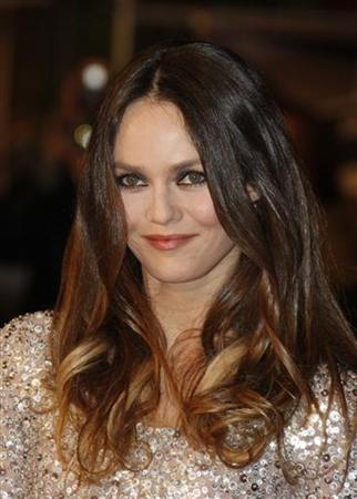 French singer Vanessa Paradis poses as she arrives at the Cannes Festival Palace to attend the NRJ Music Awards in Cannes, southeastern France January 26, 2008. REUTERS/Gilbert Tourte
